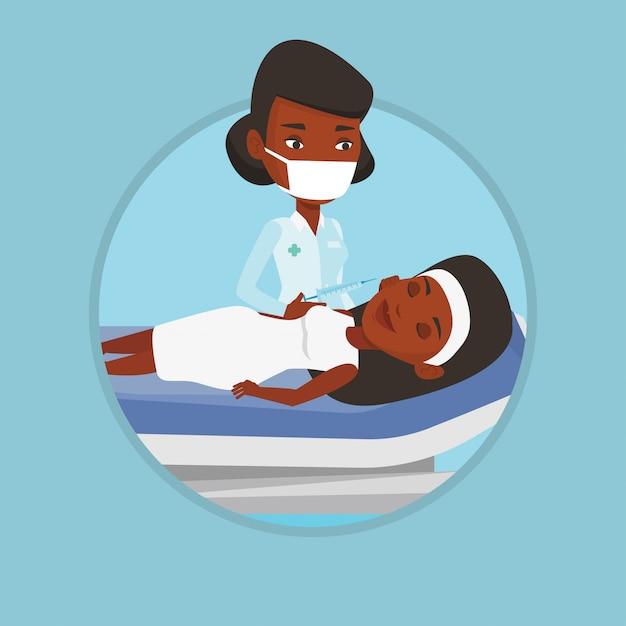 Mulher recebendo injeções faciais de beleza no salão. Vetor Premium
