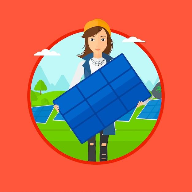 Mulher segurando o painel solar. Vetor Premium