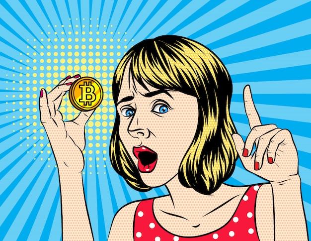 Mulher segurando um bitcoin Vetor Premium
