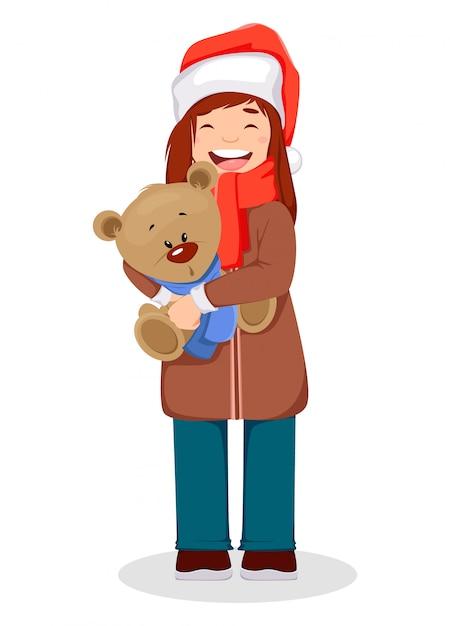 Mulher segurando um urso branco no natal Vetor Premium