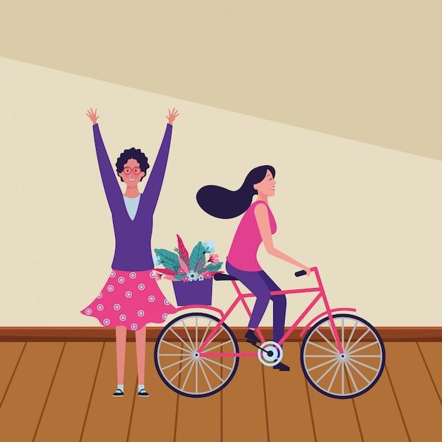 Mulheres andando de bicicleta com flor Vetor Premium