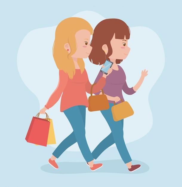 Mulheres bonitas andando usando smartphones Vetor grátis