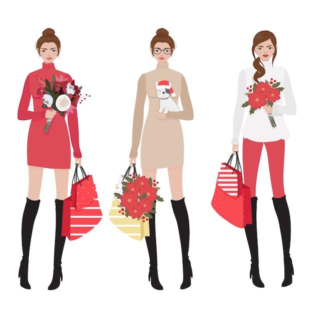 Mulheres bonitas na coleção de compras de fantasia de natal de inverno vermelho Vetor Premium