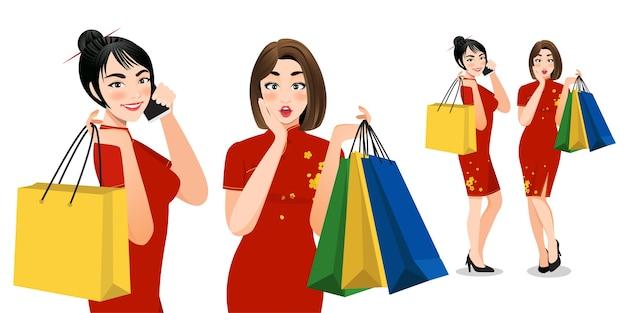 Mulheres chinesas em vestido cheongsam segurando sacolas de compras personagens de desenhos animados Vetor Premium