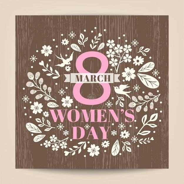 Mulheres dia saudação com ilustração floral na textura de madeira fundo Vetor grátis