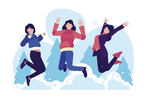 Mulheres vestindo roupas de inverno pulando Vetor grátis