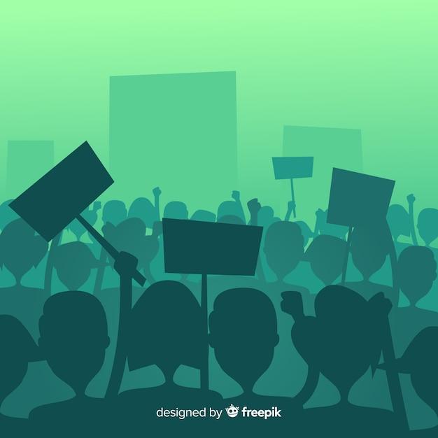 Multidão de silhueta de pessoas com bandeiras e banners em uma manifestação Vetor grátis