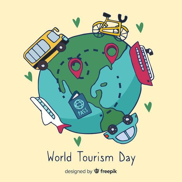 Mundo desenhado de mão com marcos e dia de turismo de transporte Vetor grátis