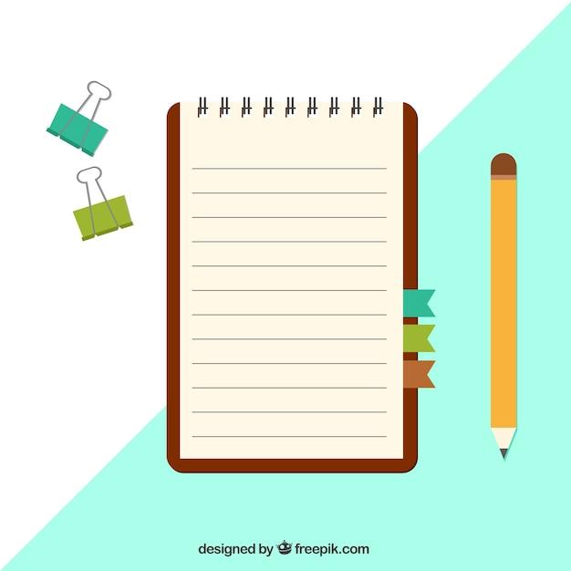 Notebook com grampos e lápis no design plano Vetor grátis