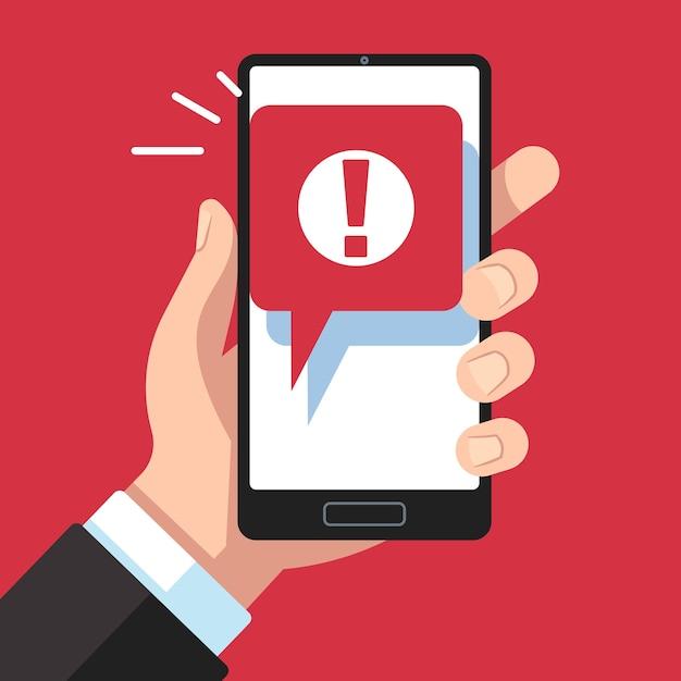 Notificação de mensagem de alerta móvel. mão segurando smartphone com sinal de exclamação Vetor Premium