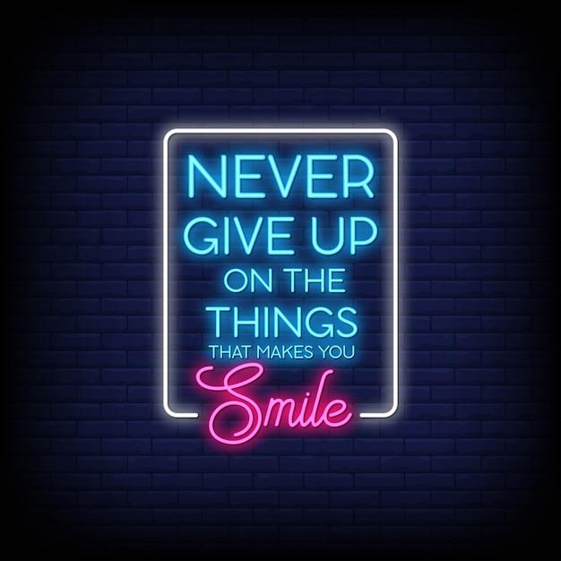 Nunca desista das coisas que o fazem sorrir sinais de néon estilo texto vetor Vetor Premium