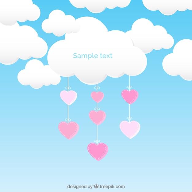 Nuvem com corações de suspensão Vetor grátis