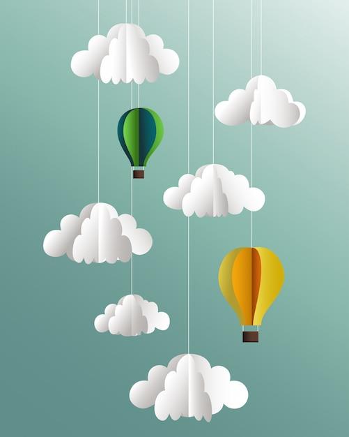 Nuvens de papel e balões em fundo azul Vetor Premium