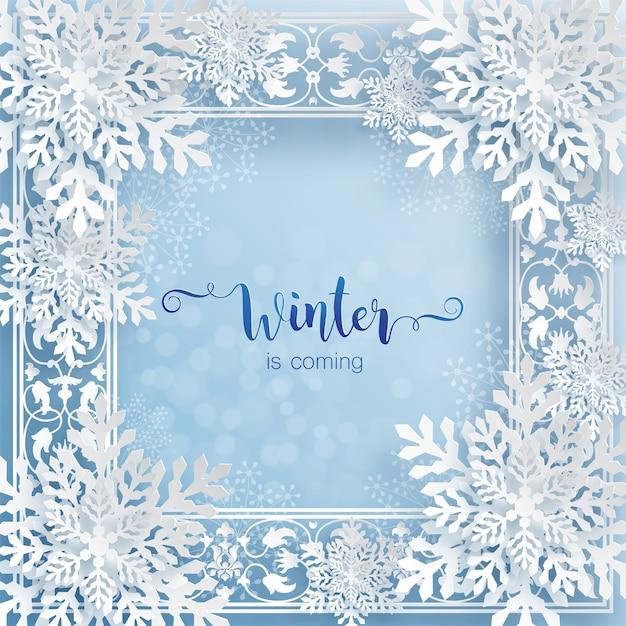 O inverno está chegando, texto em cartão de inverno com moldura de flocos de neve em estilo de corte de papel Vetor Premium