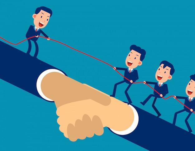 O líder ajuda o outro empresário a alcançar a meta e subir. Vetor Premium