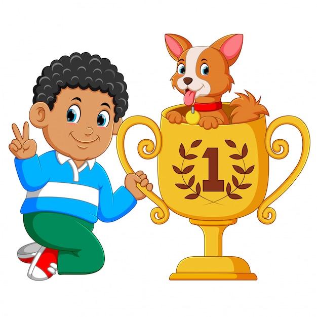 O menino que é o primeiro posto está segurando seu troféu com o cachorro nele Vetor Premium
