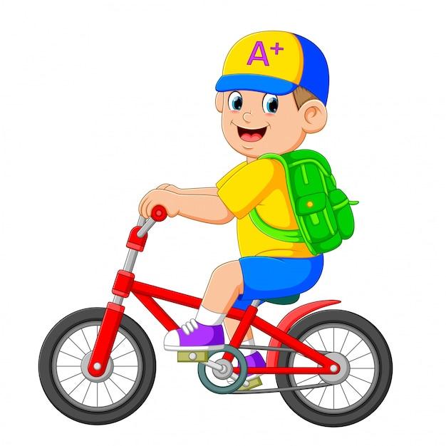 O menino vai a escola com a bicicleta vermelha Vetor Premium