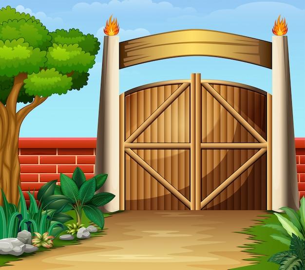 O portão de madeira em uma bela natureza Vetor Premium
