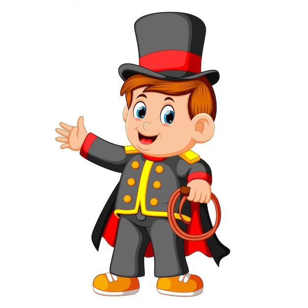 O rapaz vestindo mágico de costum Vetor Premium