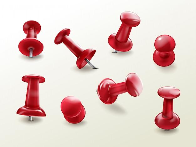 O thumbtack do escritório dos artigos de papelaria, jogo realístico de pinos lustrosos vermelhos do impulso para fixar na placa lembra Vetor grátis