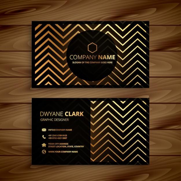 O ziguezague preto e dourado à moda dá forma ao cartão de visitas Vetor grátis