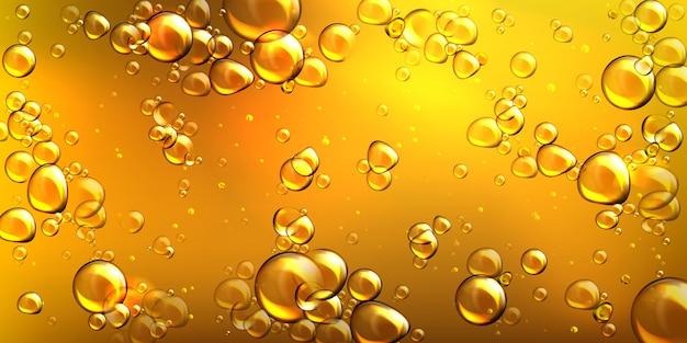 Óleo amarelo realista de vetor com bolhas de ar Vetor grátis