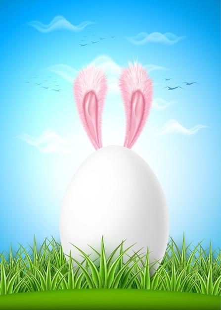 Orelhas de lebre realista ovo de páscoa grama verde Vetor Premium