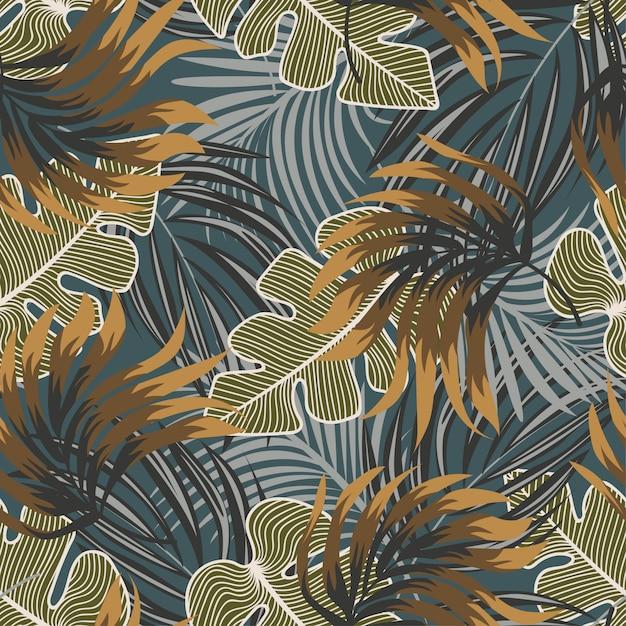 Original abstrato padrão sem emenda com folhas tropicais coloridas e plantas em fundo azul Vetor Premium