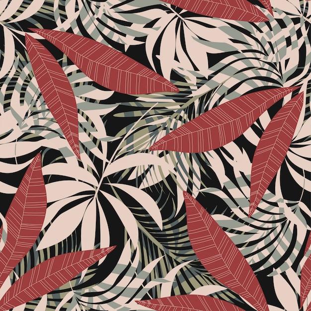 Original abstrato padrão sem emenda com folhas tropicais coloridas e plantas em um fundo escuro Vetor Premium