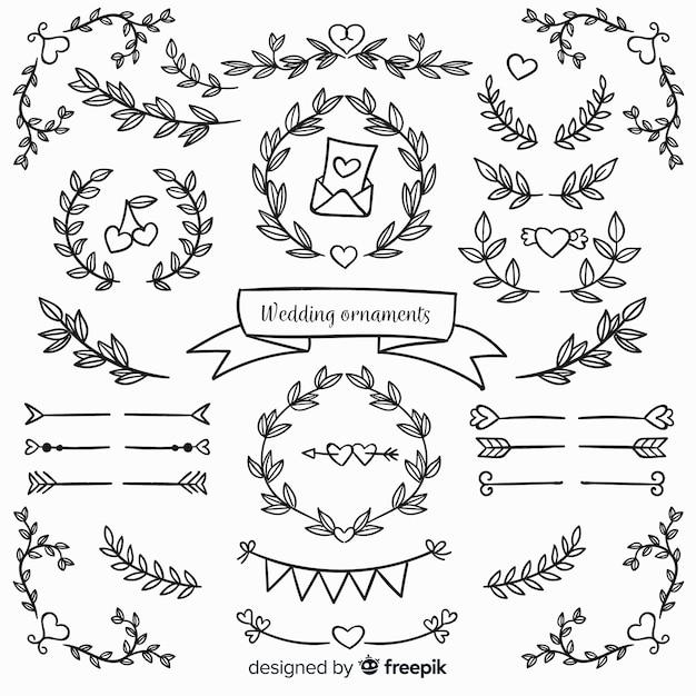 Ornamentos de casamento floral mão desenhada Vetor grátis