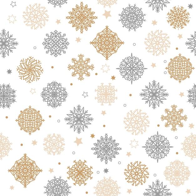 Ouro e silvern flocos de neve e estrelas sem costura padrão Vetor Premium