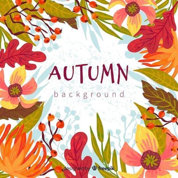 Outono de mão desenhada deixa o fundo Vetor grátis
