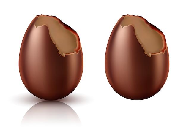Ovo de chocolate inteiro e mordido vetor realista Vetor grátis