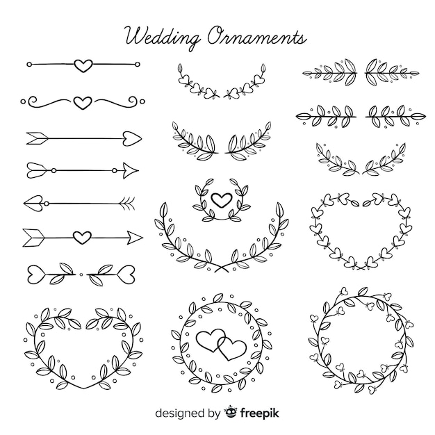 Pacote de enfeites de casamento floral mão desenhada Vetor grátis