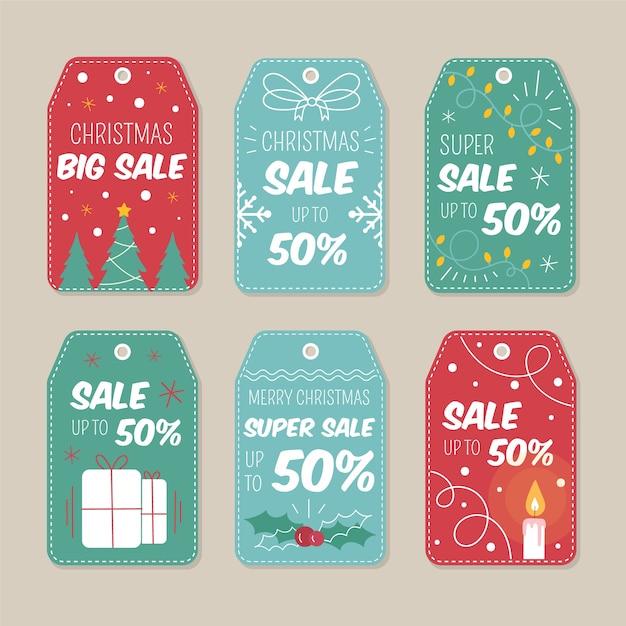 Pacote de etiqueta de venda de natal de mão desenhada Vetor grátis