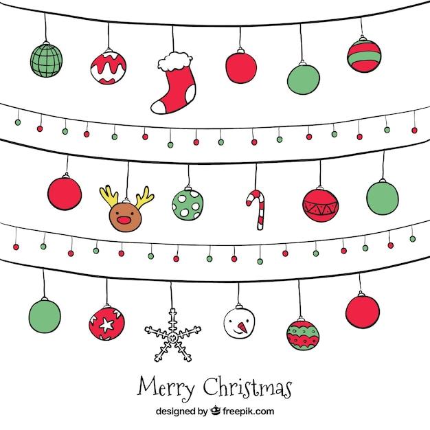 Pacote de guirlandas de natal com esferas desenhados mão Vetor grátis