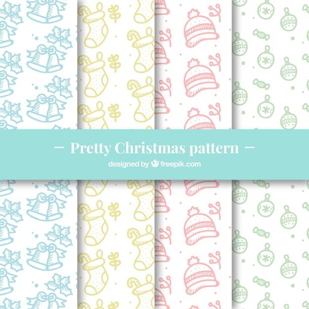 Pacote de padrões de natal desenhados à mão Vetor grátis