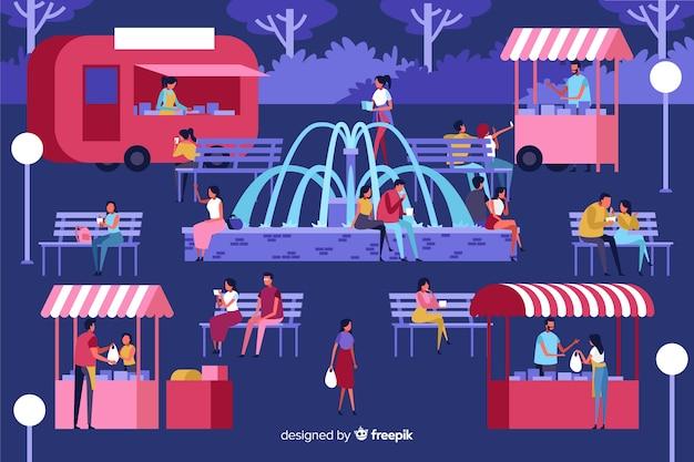Pacote de pessoas em uma feira de noite Vetor grátis