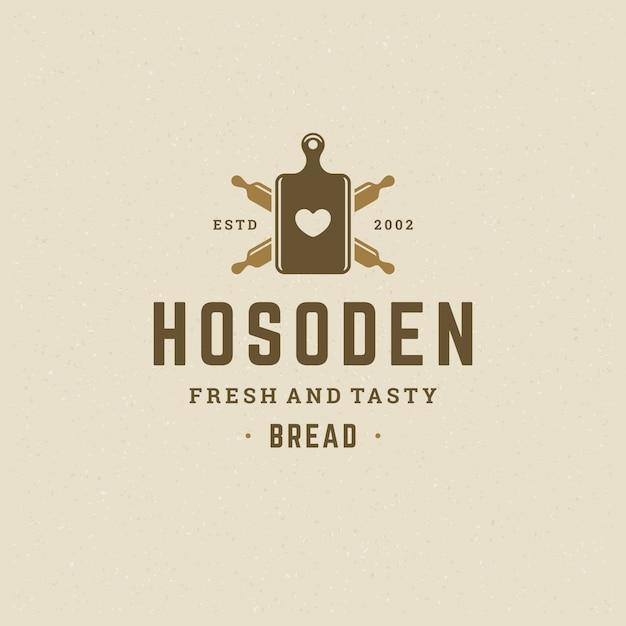 Padaria logotipo ou emblema ilustração em vetor vintage pinos silhueta para loja de padaria Vetor Premium