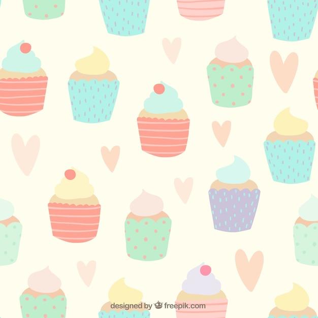 Padrão de cupcakes bonitos Vetor grátis