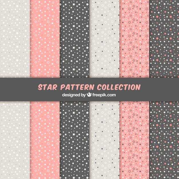 Padrão de estrelas rosa, branco e preto Vetor grátis