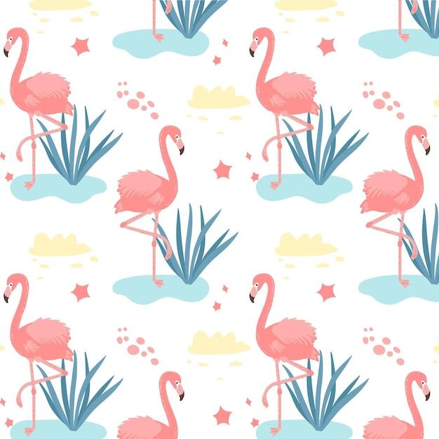 Padrão de flamingos com folhas tropicais na água Vetor grátis