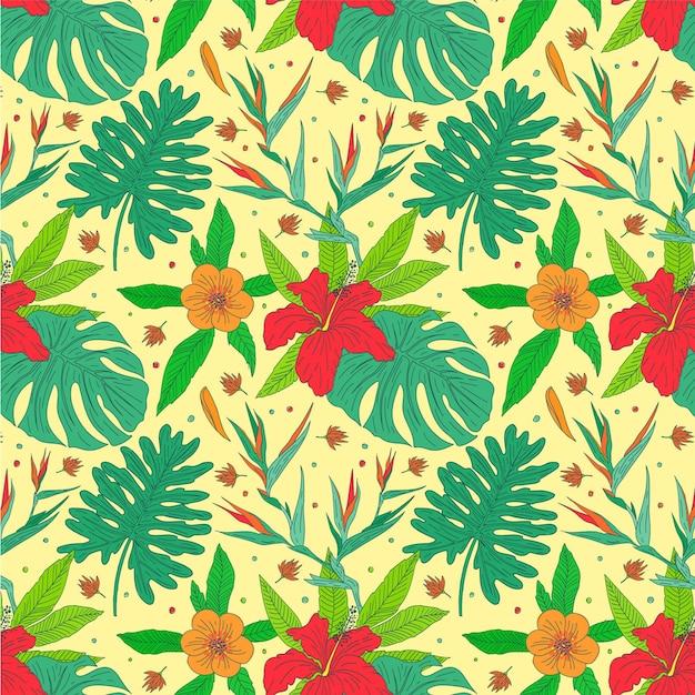Padrão de folhas e flores exóticas coloridas Vetor grátis