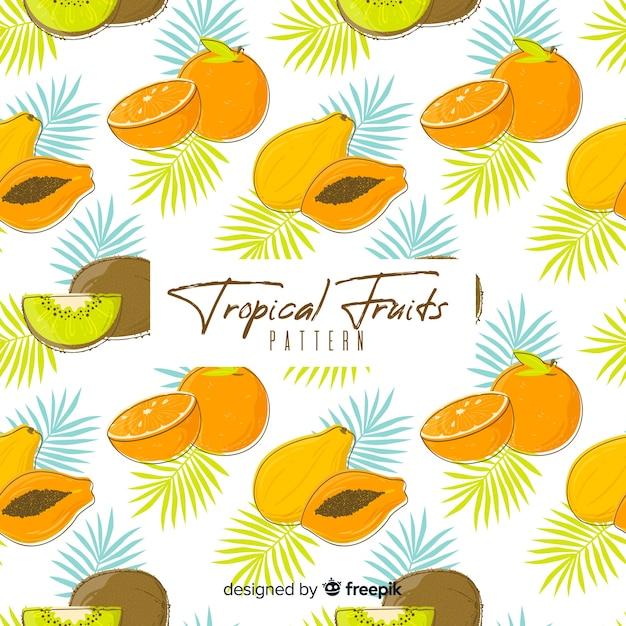 Padrão de fruta tropical desenhada de mão Vetor grátis