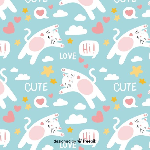 Padrão de gatos e palavras de mão desenhada Vetor grátis