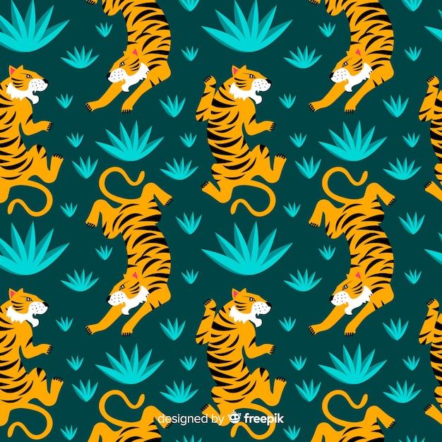 Padrão de tigre selvagem desenhada de mão Vetor grátis