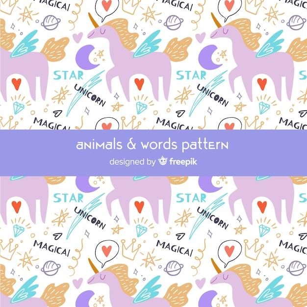 Padrão de unicórnios e palavras coloridas doodle Vetor grátis