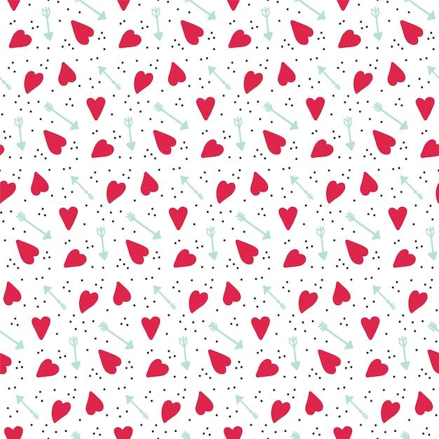 Padrão de vetor sem costura romântico com corações e flechas. Vetor Premium