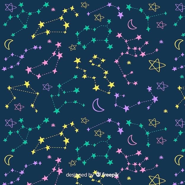 Padrão de zodíaco colorido de mão desenhada Vetor grátis