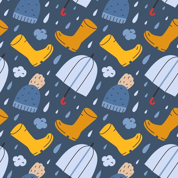 Padrão sem emenda com botas de chuva e guarda-chuva Vetor Premium